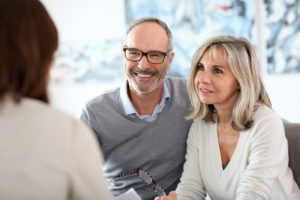 older couple consulting with professional